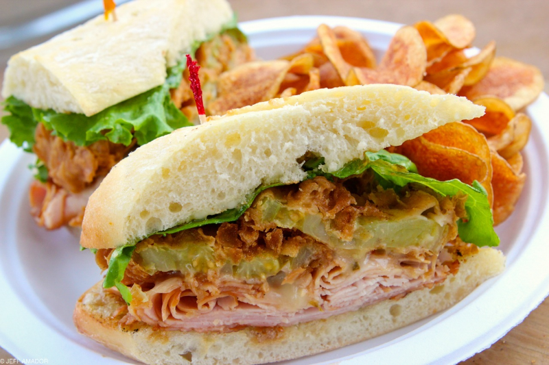 Mesquite smoked turkey sandwich with jalapeno jelly, green leaf lettuce, pepperjack cheese, and fried green tomatoes.