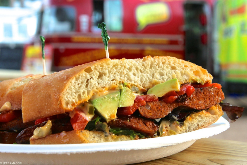 Chorizo sandwich special at Hey! You Gonna Eat or What?, with roasted red peppers, avocado, green leaf lettuce, and habanero aioli.