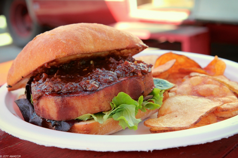 Pork chop sandwich special at Hey! You Gonna Eat or What?, featuring a thick cut pork chop topped with apple and raisin chutney (please bottle this!), and a bit of green leaf lettuce. All sandwiches come with a side of fresh cut and fried potato chips.