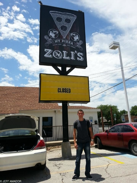 Zoli's was not closed when I went. This is an old photo, as it started randomly pouring down rain right as arrived at Zoli's, thus not allowing me to capture their impressively-irreverent sign slogan of the day.