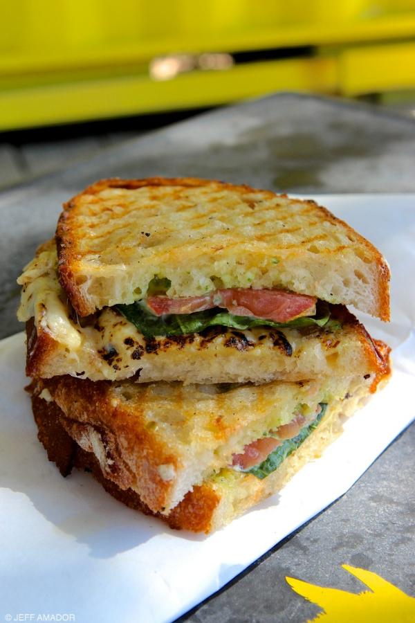 "Burro Cheese Kitchen's ""Coppola,"" their twist on a caprese sandwich with gouda, almond-pesto aiolo, fresh basil, and tomatoes."