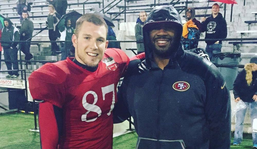 San Francisco 49ers assistant coach Brian Johnson on the sideline with Oakland County Racers Wide Receiver Aaron Wascha. 4/30/2016