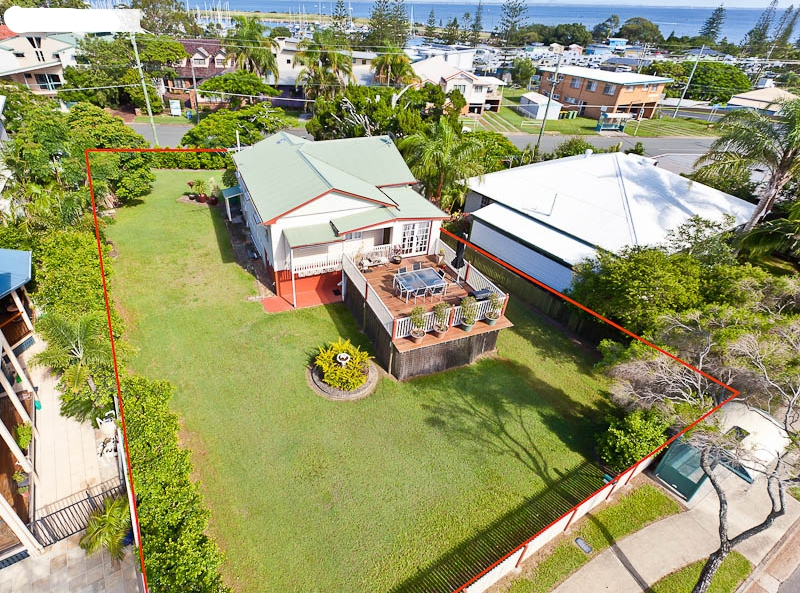 Beach House Renovation With D.A Potential. - One of my favourite projects was the renovation of this 1920's style cottage that was a run down mess at the time of purchase.The previous owner who had lived there for 50 years had passed away and it was the first time the property was being offered for sale since.The potential here was screaming since it ticked a lot of boxes - prestige location, elevated flat block with two street frontage, DA potential to build to 12 metres (3 stories) which gave panoramic views of Moreton Bay, not to mention the lifestyle aspect of the beach, boat club, cafes and parks.The renovation took around 3 months full time and the transformation was incredible.This was one of my proudest and most enjoyable renovations and the equity gain was healthy considering this property was purchased when the market had hit a bit of a stale mate.