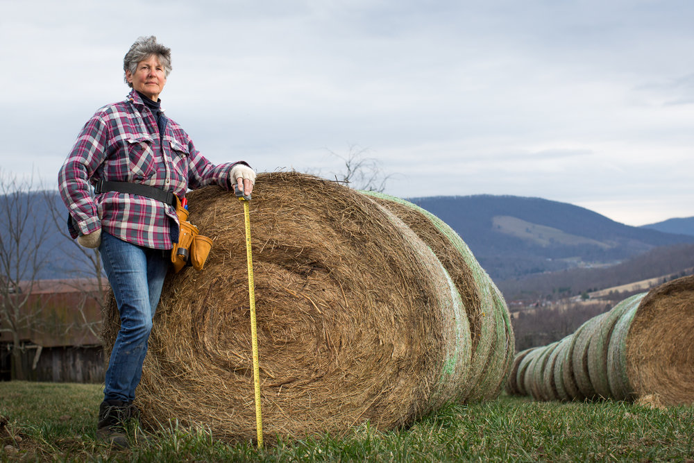 Virginia farmer Georgia Haverty uses a roll of hay to show the size of the 42-inch diameter natural gas pipeline that scheduled to go through her farm.