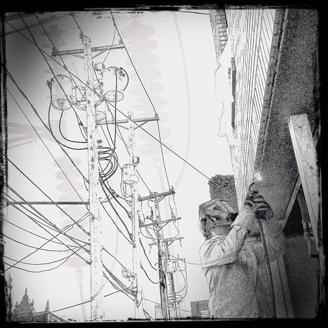 Ian English of @enginehousepgh welds the steel to #711james in prep for the hanging of THE doors.  I could not resist playing with the crazy electric lines along James street in #Hipstamatic.  We'll be ready in time for the #deutschtownmusicfestival with guest appearance from @magicphotobus July 13 & 14. #pgh #412 #15212 #studiopgh
