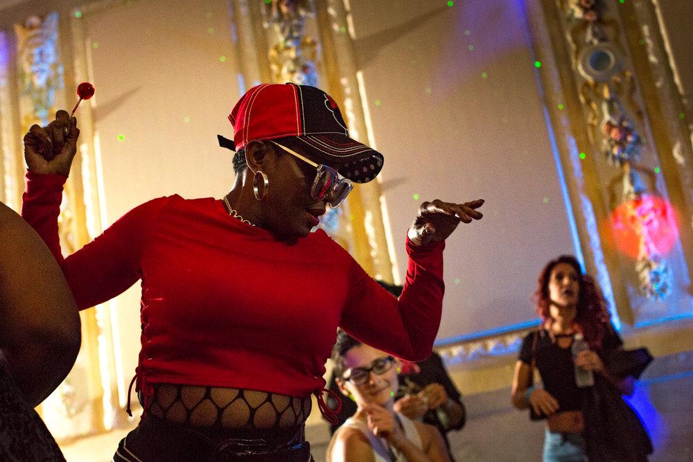 Released: Ramona Jones in red with cap and loipop. Angela Urban dancing under arm.