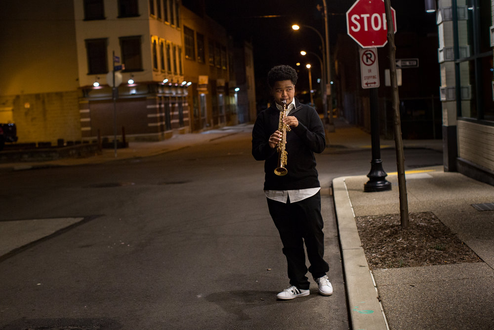 "Winston Bell, son of Poogie Bell and member of the All-Stars plays on the street outside the theater ad guests come in for the show. Kelly-Strayhorn Theater rehearsal and performance ""Poogie Bell and His All-Stars"" for The 10th annual Suite Life is a musical tribute to the life and legacy of KST namesake Billy Strayhorn. Reared in Homewood, the legendary pianist, arranger, and composer studied music at an early age, then joined a musical ensemble, performed on local radio, and wrote music, before making an indelible mark in the world of jazz. For decades, Strayhorn made essential contributions to The Duke Ellington Orchestra, sharing in a rich collaboration and shaping American songwriting and culture. This year's concert features Poogie Bell and His All-Stars remixing and reimagining Strayhorn's classics as we celebrate his continued influence on artists today and work to ensure that his work inspires generations to come. 