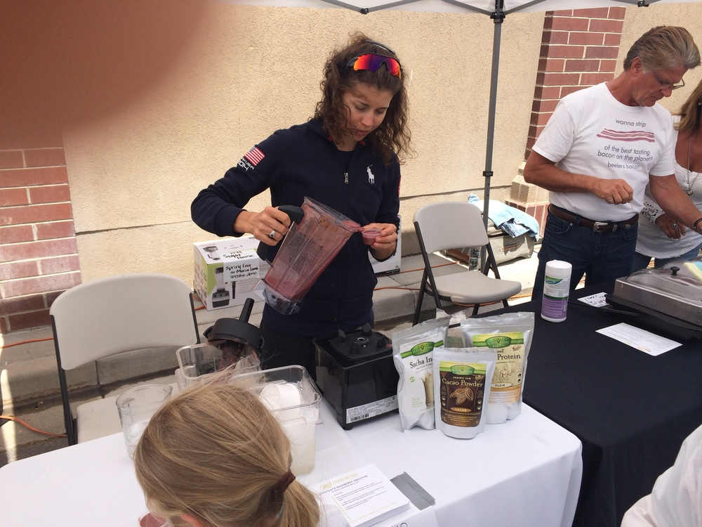 Maria Lamb serving her smoothie recipe samples.