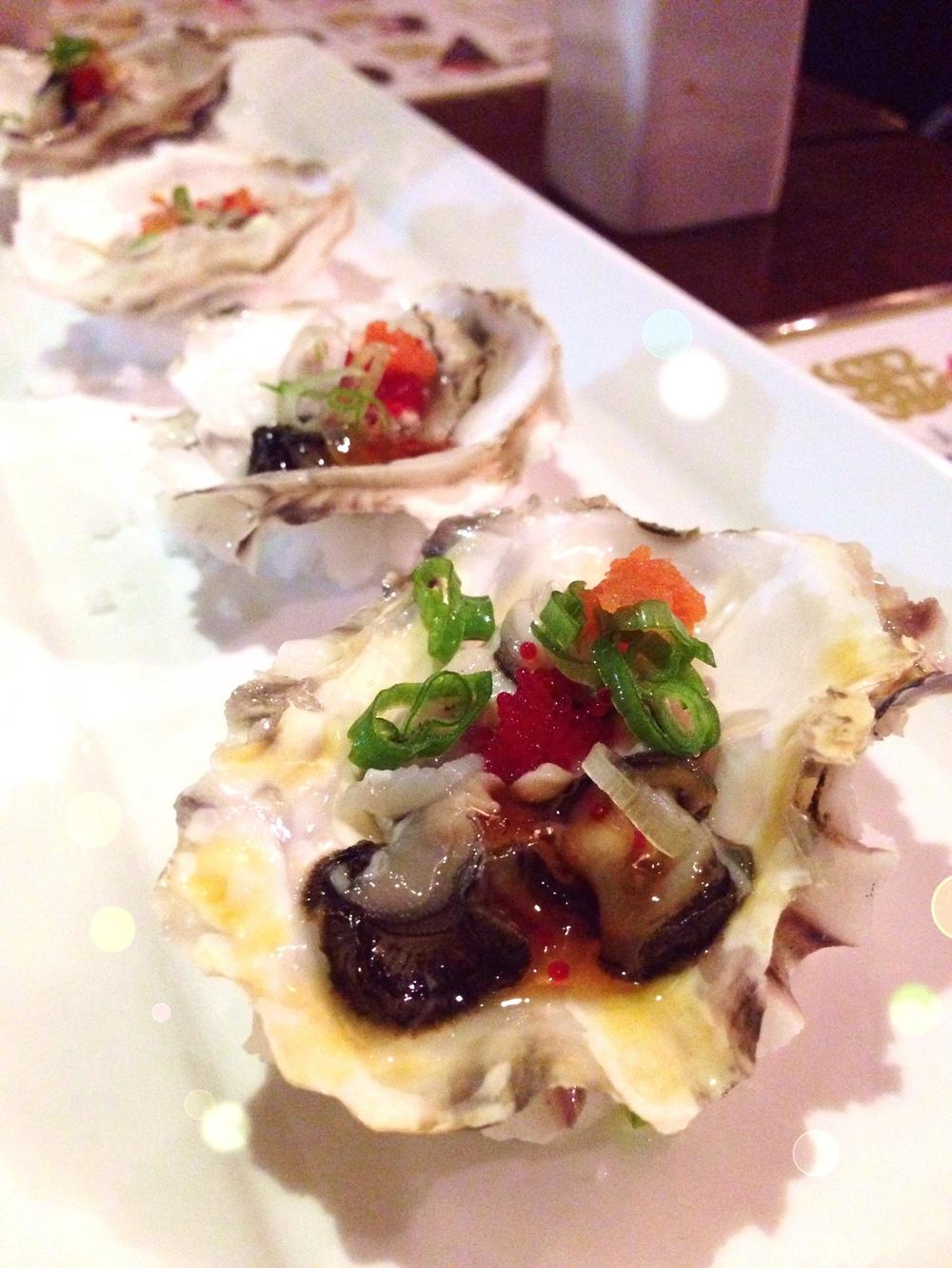 Oyster with Ponzu Sauce: Seasonal oyster, scallion, momiji oroshi, tobiko, ponzu jello.