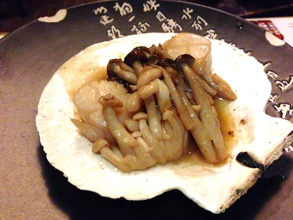 Scallop on Half Shell: Hokkaido scallop, butter, soyu, sake, shimeji mushroom.