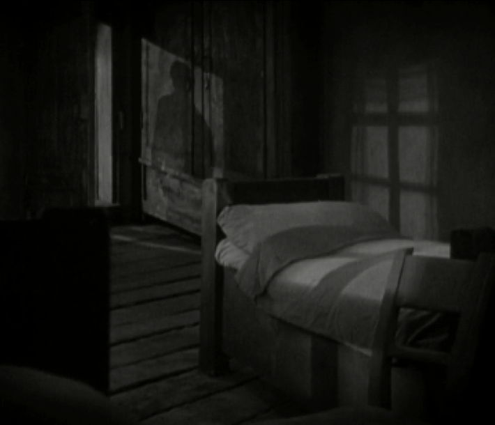 Image 2. A strong silhouette is cast on the wardrobe placed in the background.