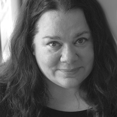 Black and white headshot image of Cara Holland