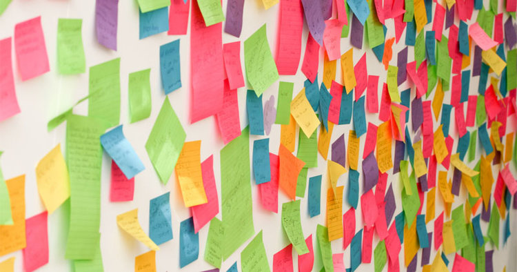 A wall covered in post-it notes