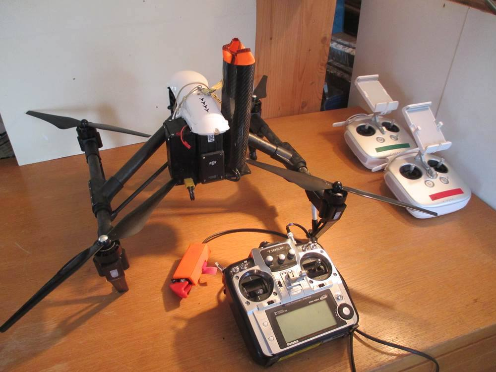 DJI Inspire 1 equipped with Skycat X55-CF. Integration made by Ueli Sager from www.remotevision.ch.  Independent radio/receiver, emergency switch and battery. System is not connected to copter electronics.  Install kit available