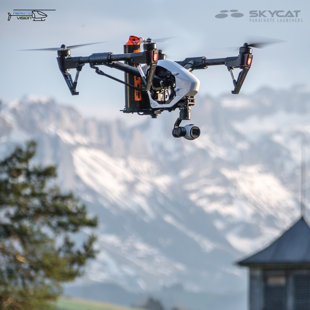 Skycat X55-CF parachute launcher installed on a DJI Inspire 1, flying over Swizerland. Photo: U. Sager / remotevision.ch