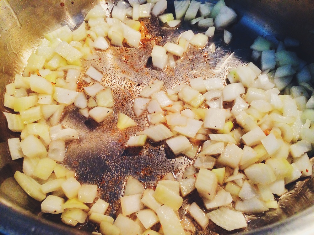 Add another glug of oil and cook the onion, parsnip, and potato until just golden and aromatic.