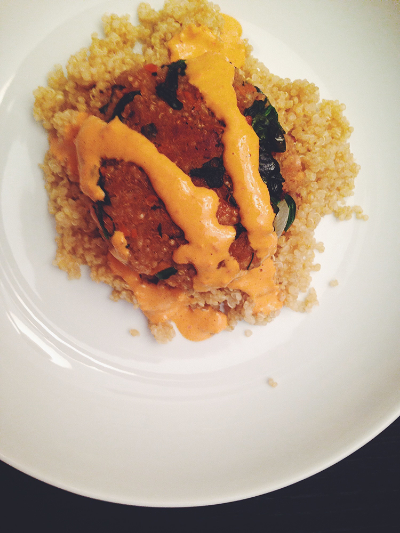 Tahini red pepper sauce drizzled over quinoa-white bean-spinach patties.