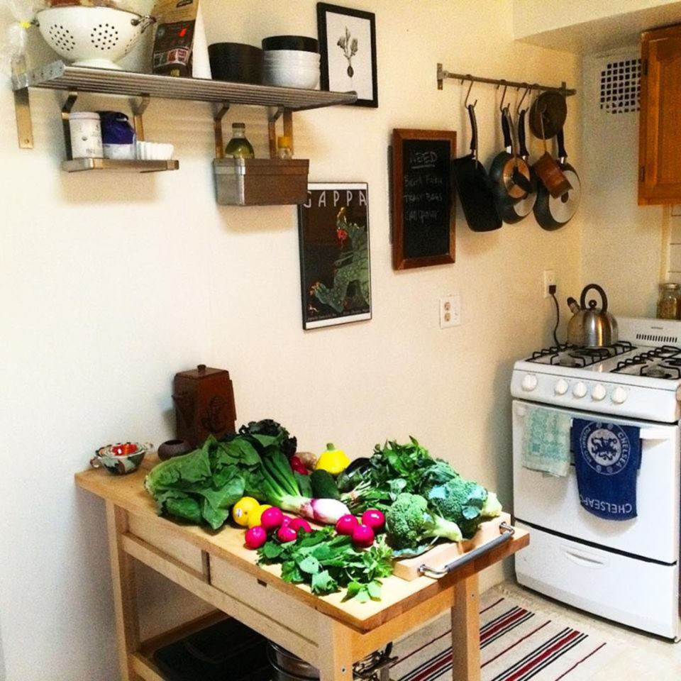 Pots and pans, kitchen utensils, on the wall: Easy way to free up cupboard space.