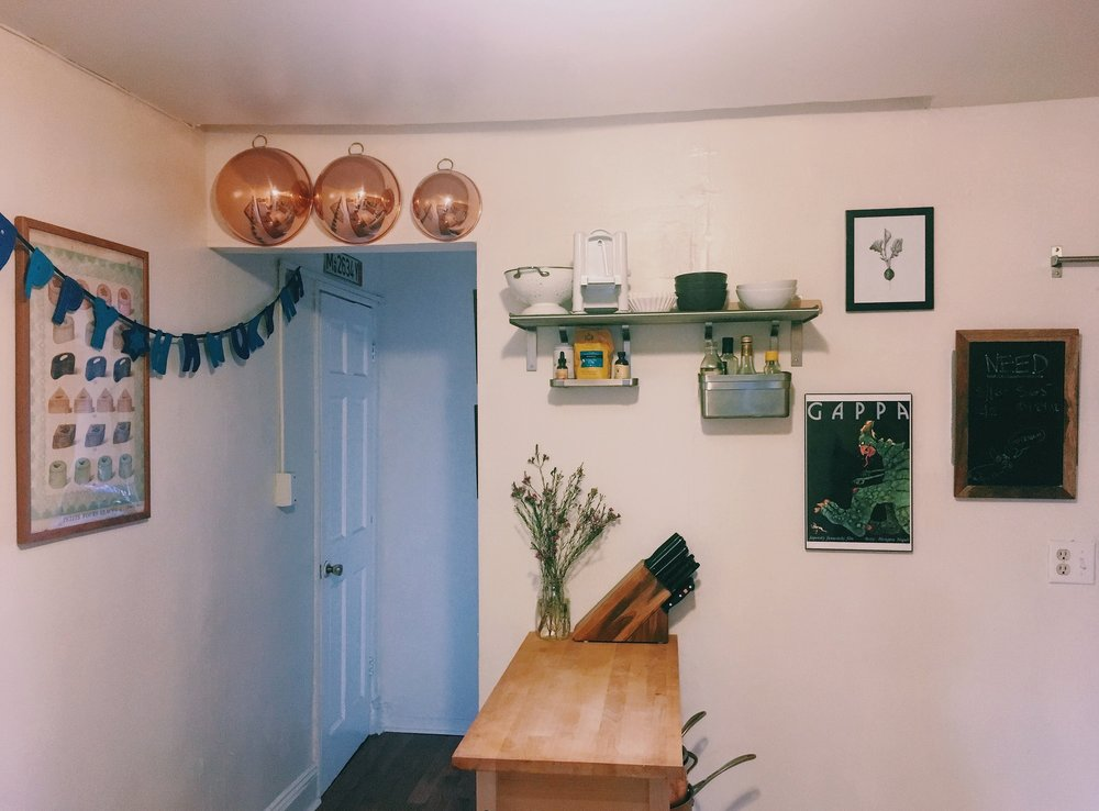 A simple Happy Hanukkah banner and some flowering seasonal branches, in our crooked kitchen.
