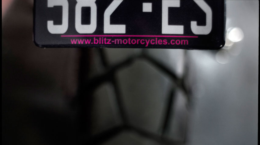 Another killer detail: purple 'Blitz Motorcycles' text on the identification plate.