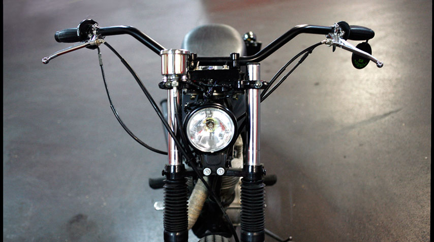Bates headlight. Wide handlebar mounted in its original condition.