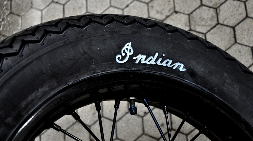 "Genuine Coker ""Indian"" tyres mounted on both front and rear wheels."