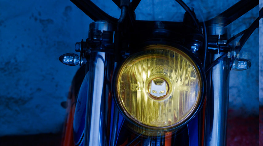 A vintage Marchal yellow headlight has been adapted to the simplified wiring. It was found in a swap meet and reconditioned before being installed.