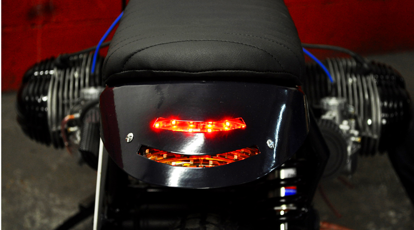 The tail light & braking light have been 100% hand made and integrated in the rear loop.