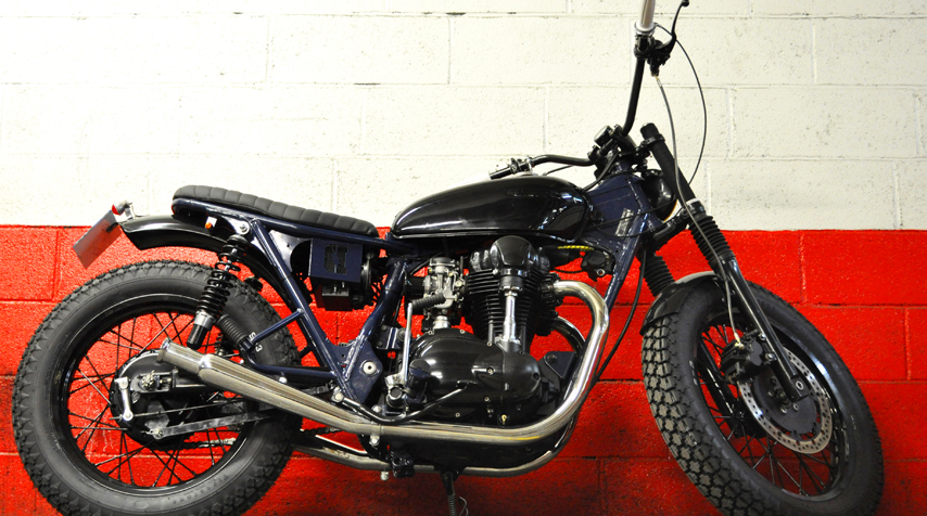 Fully reworked Kawasaki W650. Frame shortened by 7 cms.  Honda CB 125  tank freshly shiny black painted.