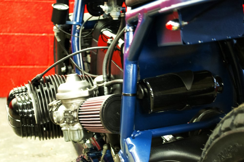 -  K&N  air filters connected tot he re-jetted  Bing  carburators;  - bespoke shiny black powder coated engine breather.