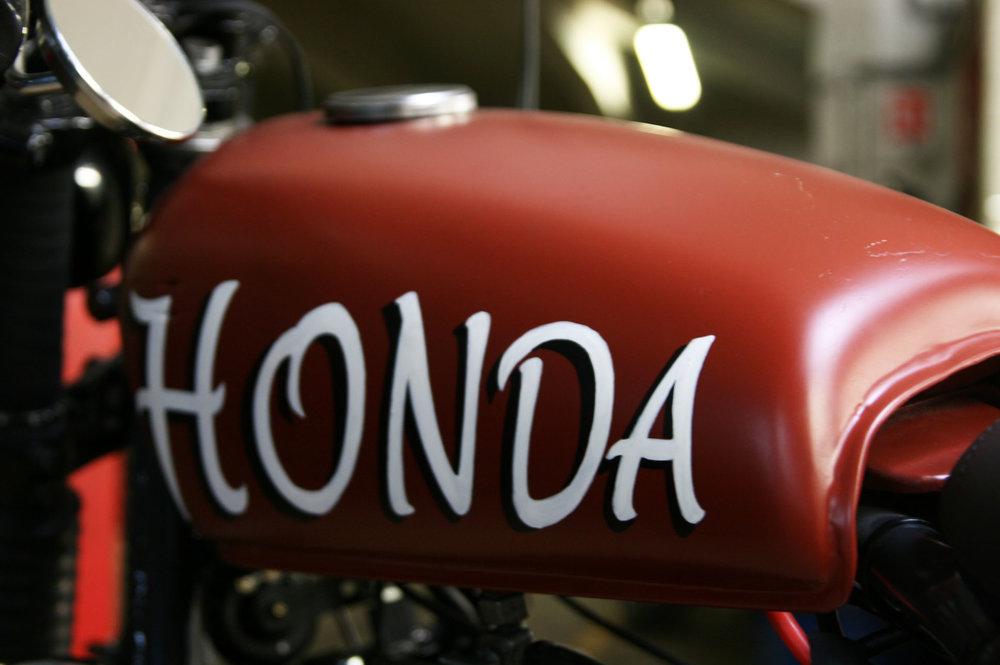 "- vintage  Honda  tank mounted ""as found"";  - ""Honda"" logo painted by Paris-based artist   Mahogany  ."