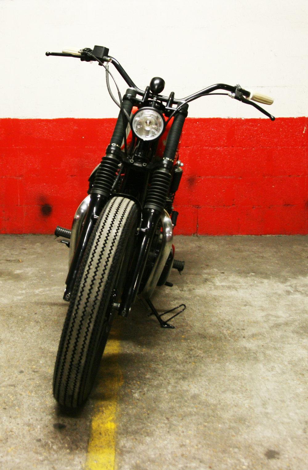 -  Brembo  front brake master cylinder;  -  Bates  type headlight.