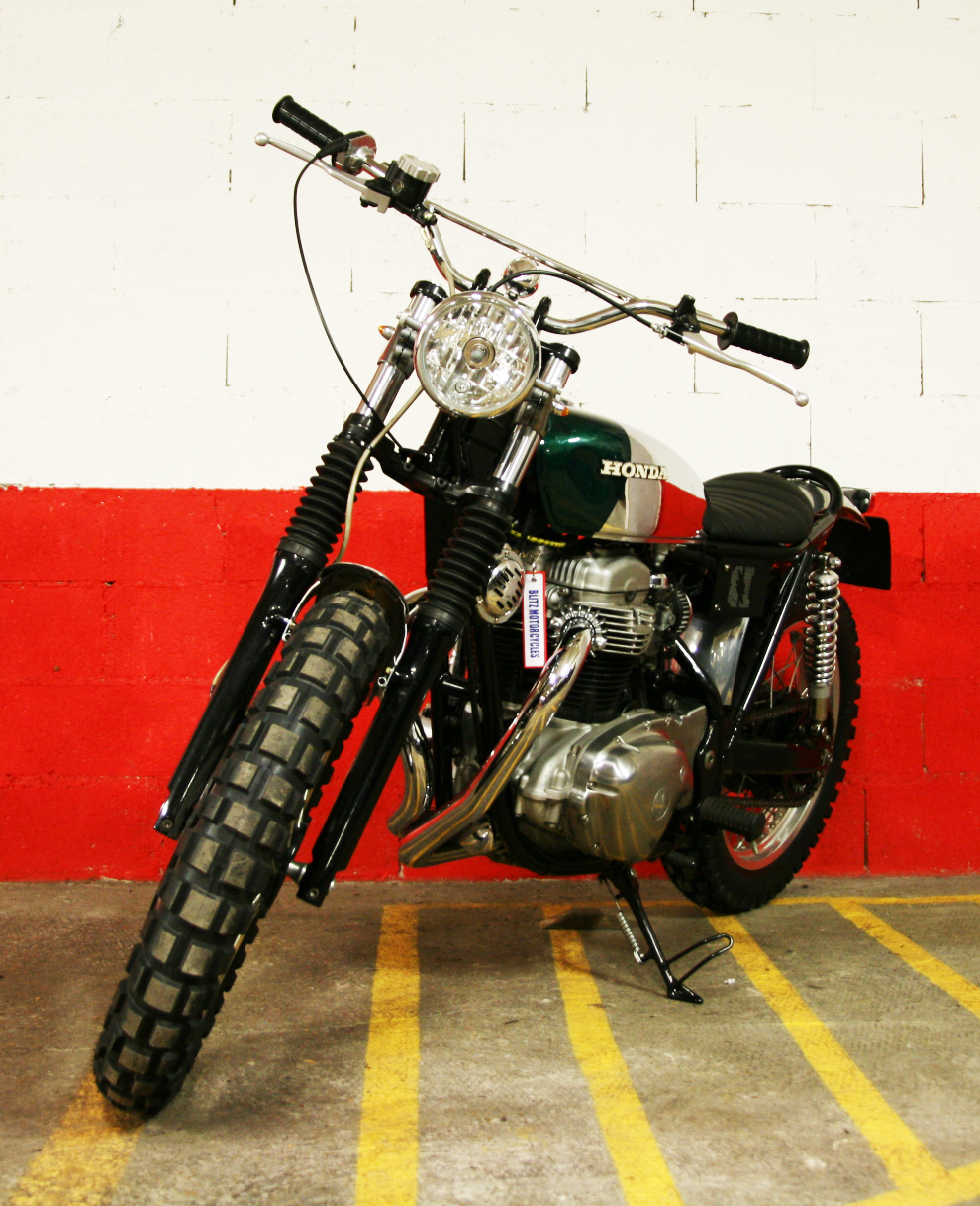 - after market chromed headlight;  - vintage motocross handlebar;  - vintage NOS  Honda  grips.