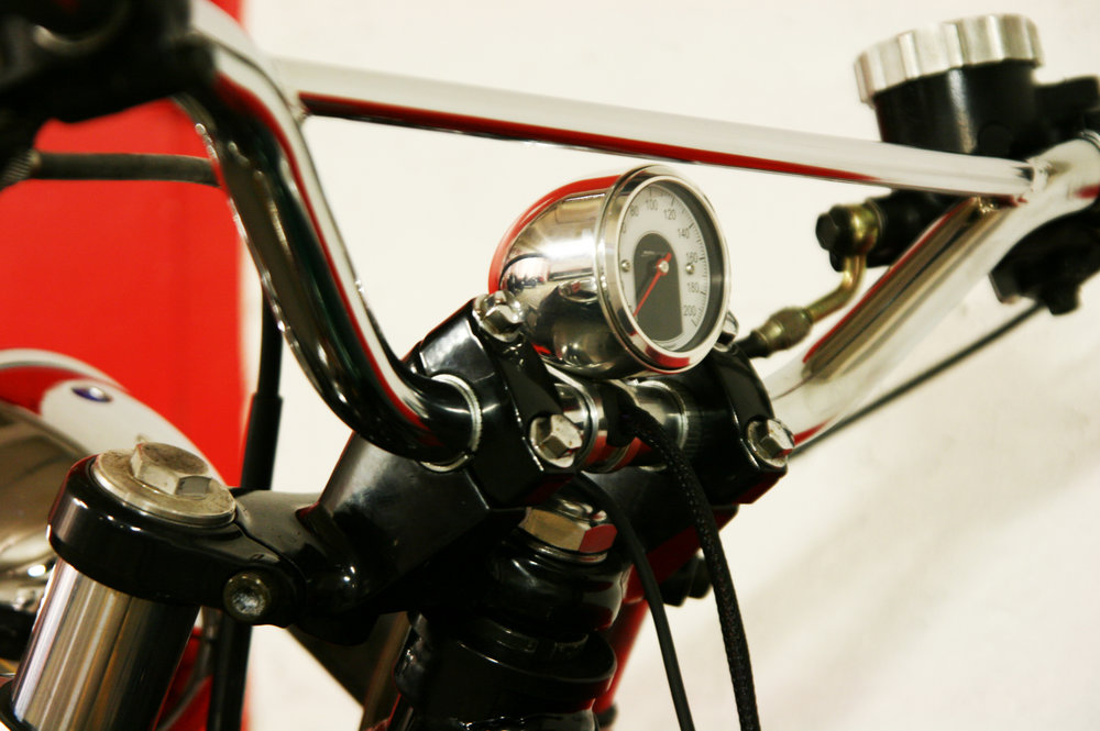 Chrome  Motogadget  tiny scope installed on the motor cross handlebar.