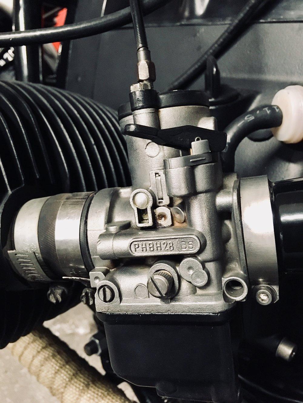 Fully reconditioned PHBH28  Dell'Orto  carburetors installed instead of the original  Bing  carburetors.