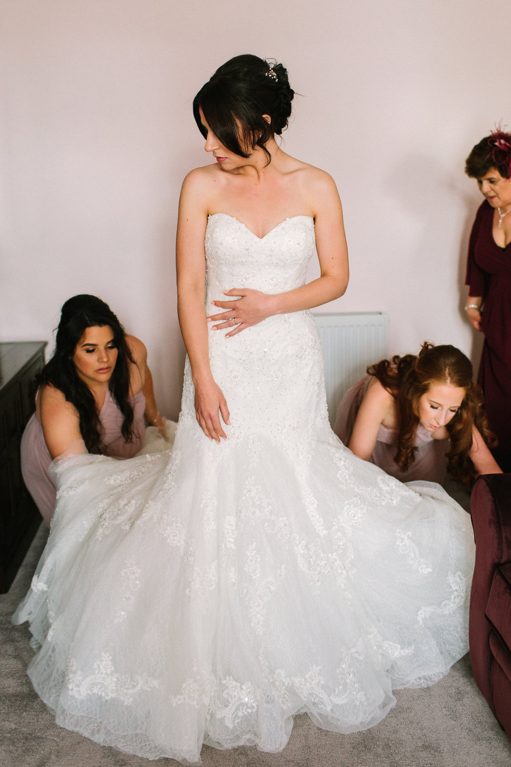 getting into the wedding dress