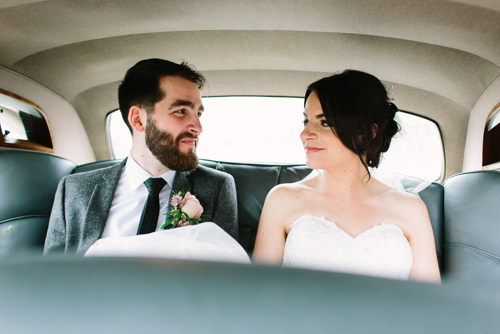 couple in the wedding car