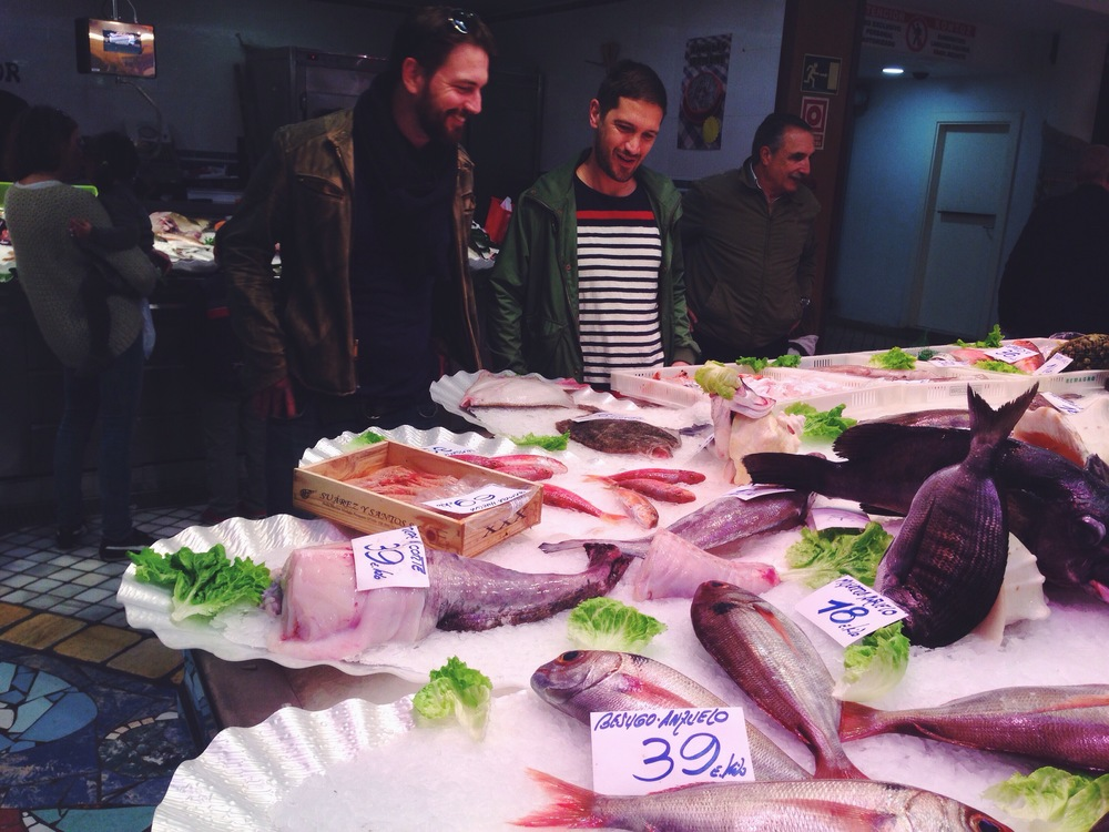 Matt & I smiling in the fish market - photo by @afickledream_