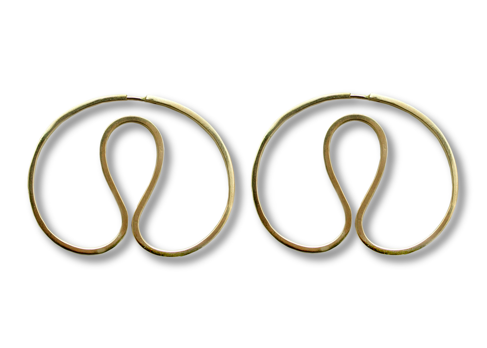 Gurmit's Yoni earrings  inspired by he yoni symbol  in 18 carat gold .