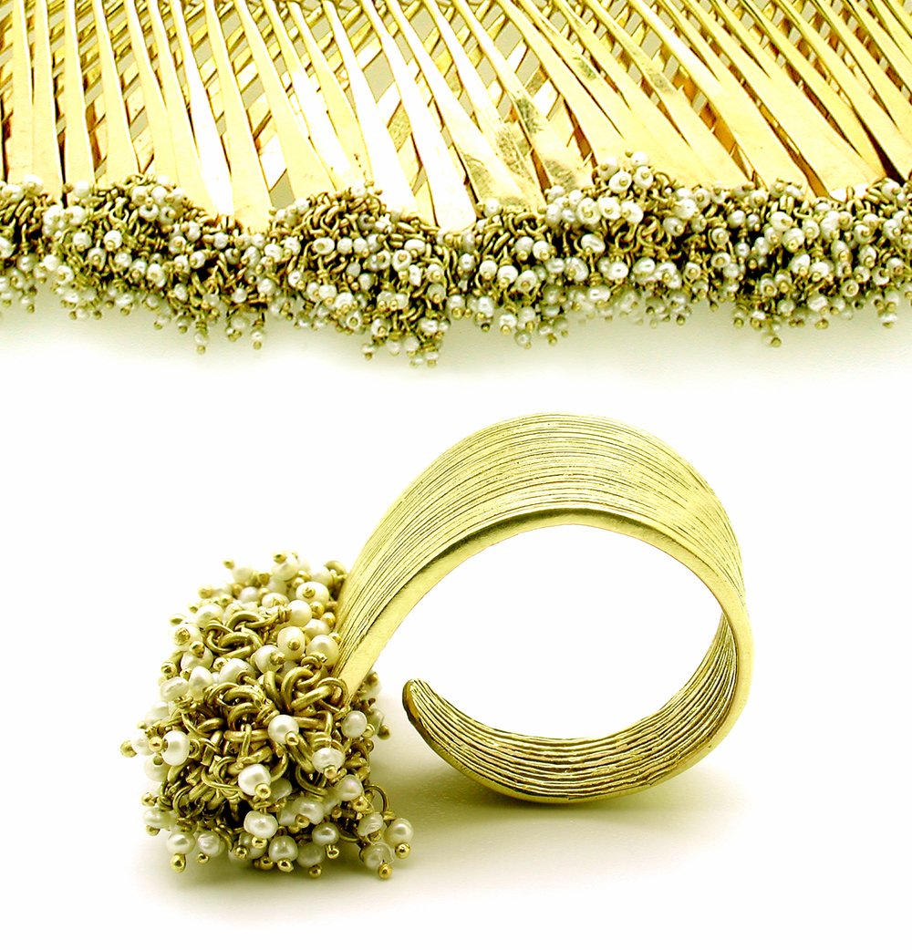 Gurmit's Zen Garden ring and necklace in 18 carat gold and seed pearls.