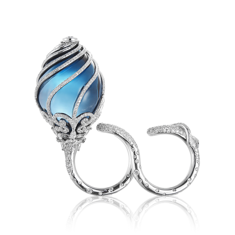 Blue Bud Ring in white gold, diamonds and Blue London Topaz by Gurmit Kaur Campbell.  Inspired by Norman Foster's architecture of the  The Gherkin ,The  Reichstag in Berlin and Karl Blossfelt's  images of nature.