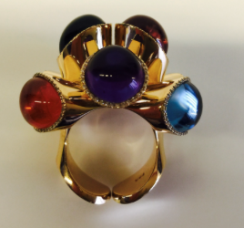 Front view of  Gurmit's Puzzel Ring in Rose Gold, diamonds, Amethyst, Mandarin Garnet, Tourmaline, Berl, Swiss Topaz, Peridot, Rubelite and London Topaz.  www.gurmit.com