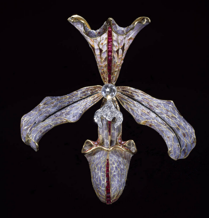 The outstanding works of Philippe Wolfers were of great importance for the entire  Art Nouveau  jewelry. Inspired by the Symbolism Movement and its dream like themes, he used gold, precious stones and expensive materials, to create luxurious jewelry, with floral, animal and natural designs, sensual female forms, with fluid, sinuous symbolic ornaments.