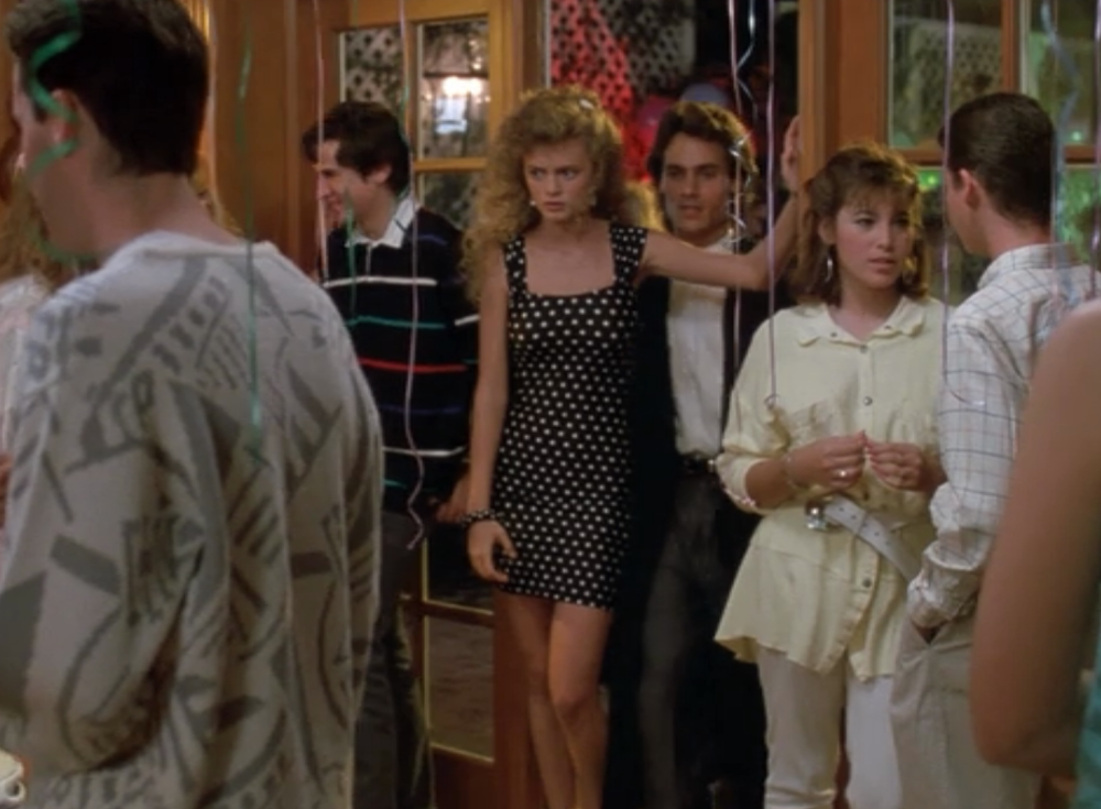 A young, disgruntled Heather Graham enters a typical '80s high-school party fed up with her older suitor's condescension and ready to be ogled by some Coreys of her own age, whom she will rope into her transparent plot device, I mean, the machinations of young love.