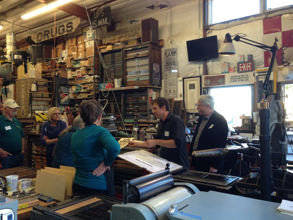 Wilson printing broadsides at an Englewood Depot fundraiser