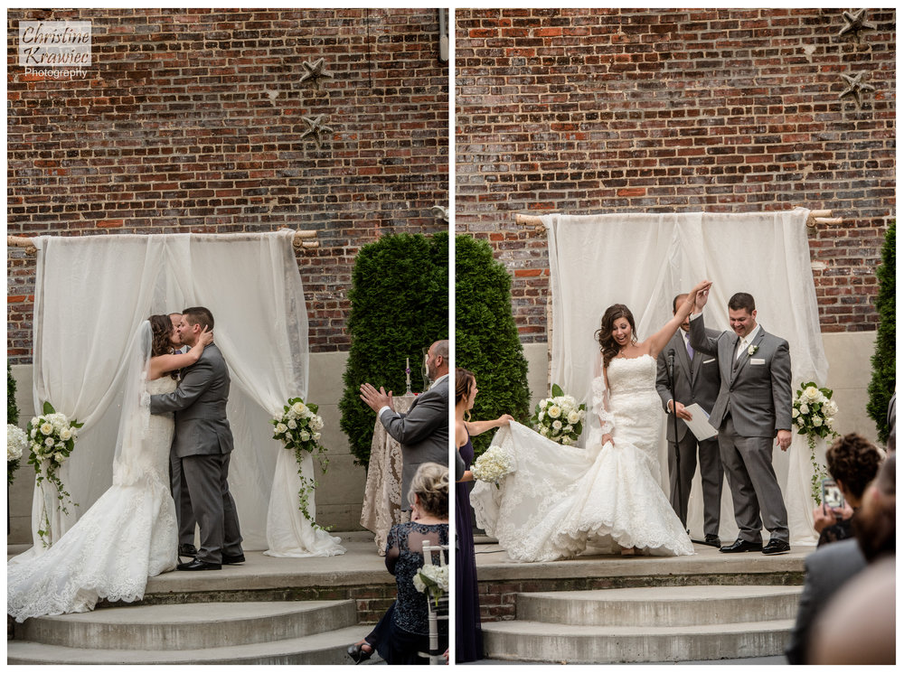 They could not be happier!  Official first kiss of the new Mr. and Mrs!