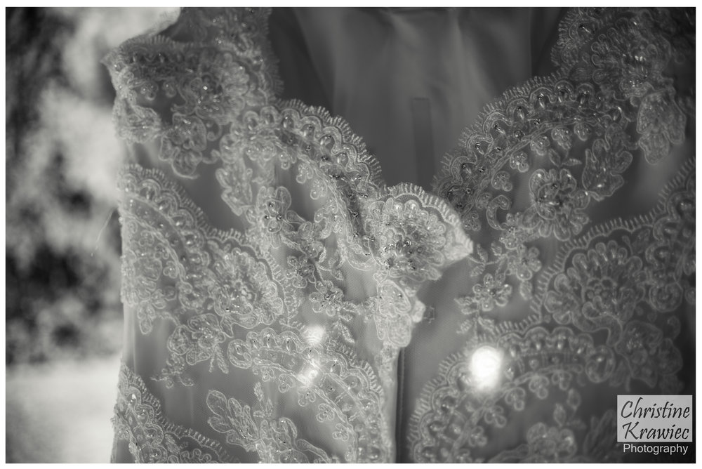 I love the scalloping detail on her gown