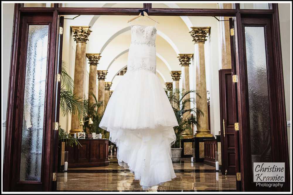 I was floored by the hallway of columns, and love how they frame her wedding dress here :)