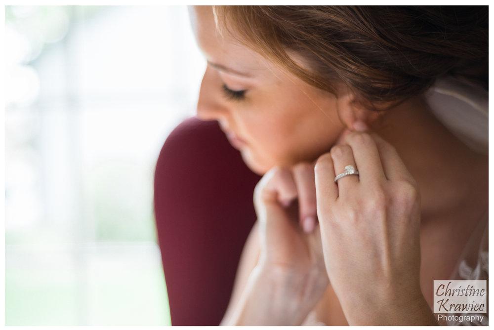11 bride-putting-on-earrings.jpg