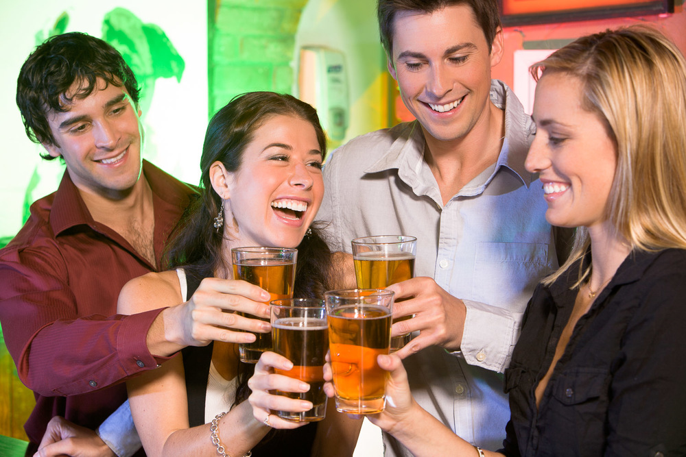 young adults celebrating with beers.jpg